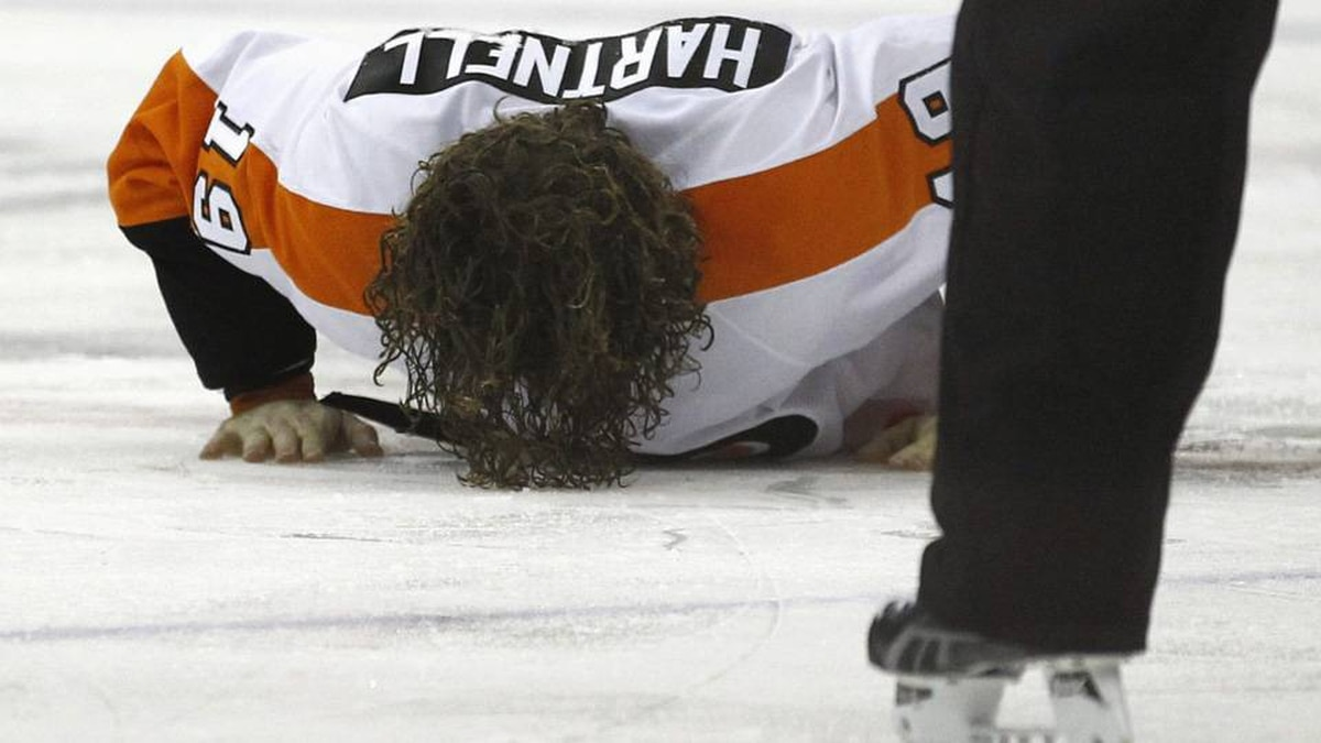 Philadelphia Flyers' Scott Hartnell picks himself off the ice after a fight against Washington Capitals' Troy Brouwer during their NHL hockey game in Washington.