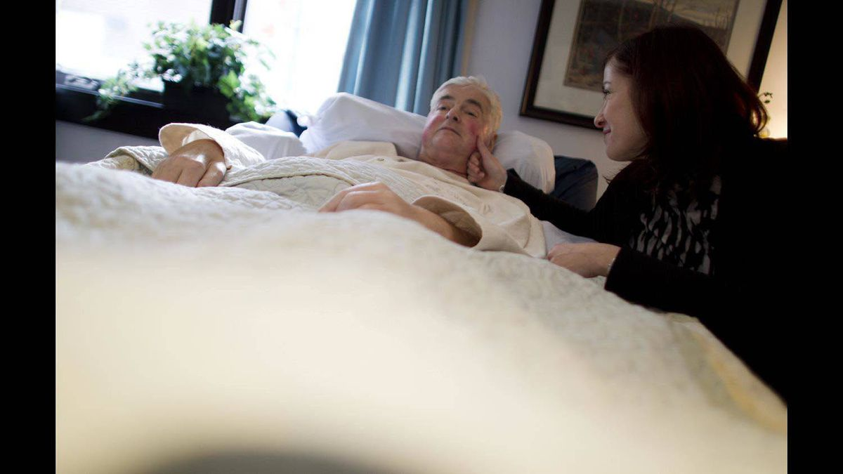 Marianne Kupina spends time with her husband, Andrew McCarthy, a resident at Kensington Hospice.