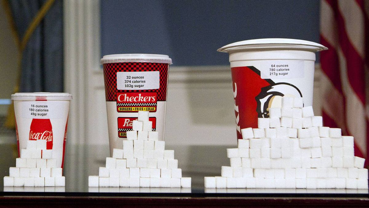 Soft drink cups are displayed at a news conference at City Hall in New York on May 31. Under a new law proposed by New York City Mayor Michael Bloomberg, all soft drinks over 16 ounces will be banned in restaurants and stores that fall under the jurisdiction of New York City.
