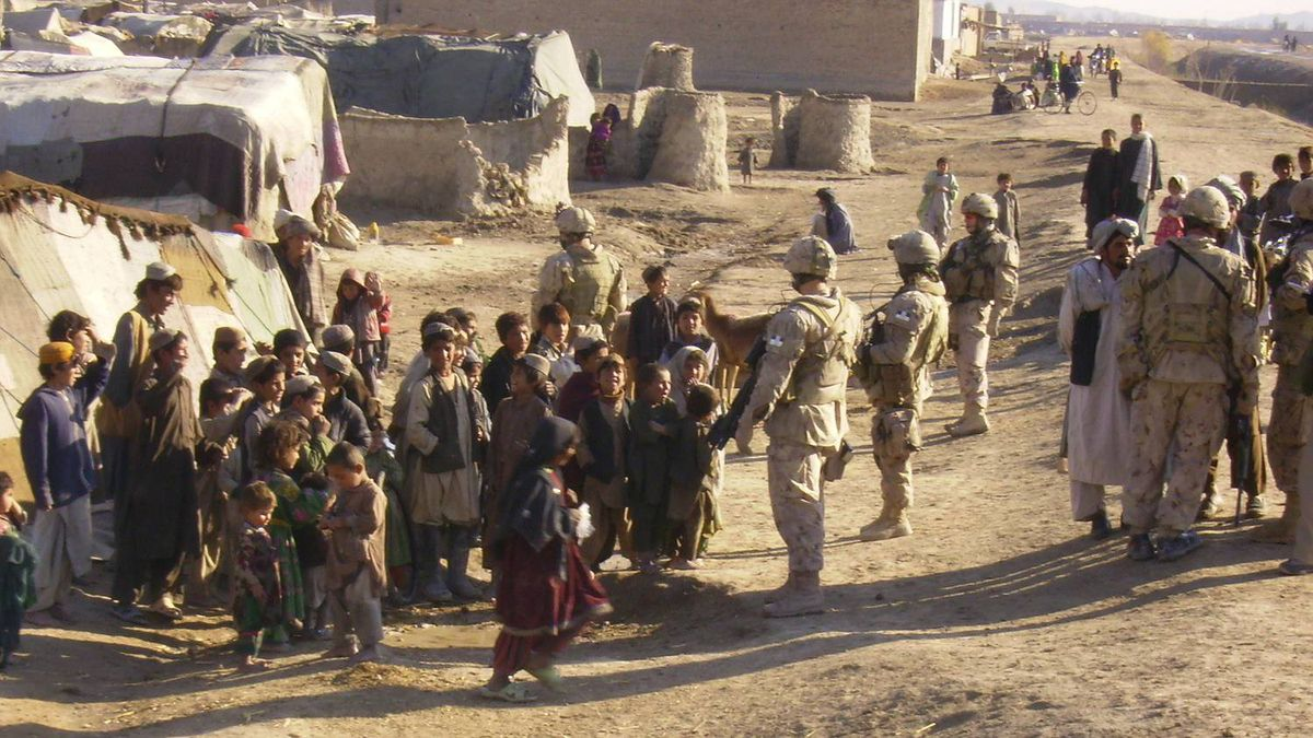 Canadian soldiers meet members of a Kuchi settlement just south of Kandahar, Afghanistan, on Dec. 30, 2009. Ninety minutes later, on their way back to base, an improvised explosive device destroyed one of their vehicles, killing four soldiers and journalist Michelle Lang and badly injuring four other soldiers and civilian Bushra Saeed.