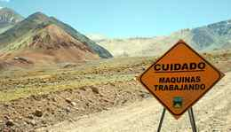 A traffic sign is seen near Barrick Gold Corp.'s Veladero gold mine, on the Argentine side of the border district between Chileês Huasco province and Argentinaês San Juan province, a few kilometers from the site for the Pascua Lama gold project, northeast of Santiago, Chile.