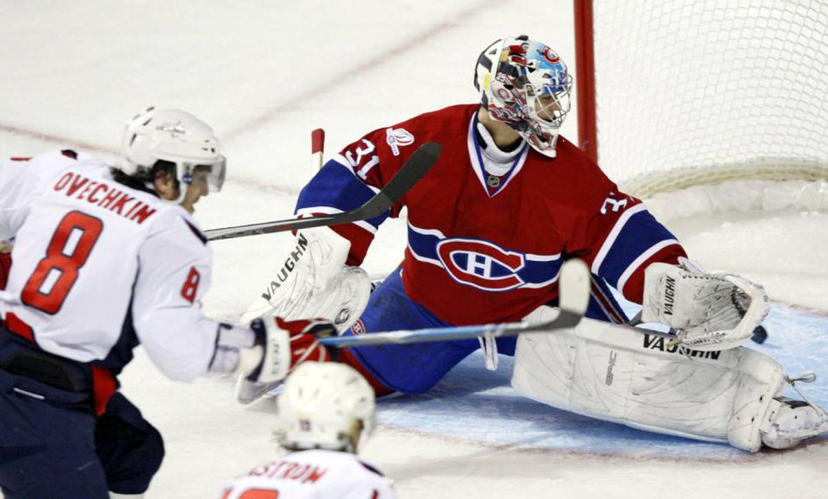 Washington Capitals' Alex Ovechin, of Russia, scores pass Montreal Canadiens goalie Carey Price during third period Game 4 NHL Eastern Conference quarter-finals hockey action Wednesday, April 21, 2010 in Montreal.