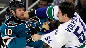 Brad Winchester #10 of the San Jose Sharks takes a punch to the mouth from Aaron Volpatti #54 of the Vancouver Canucks during an NHL hockey game at HP Pavilion at San Jose on November 26, 2011 in San Jose, California. The Canucks announced on Saturday that Volpatti will require season-ending shoulder surgery. (Photo by Thearon W. Henderson/Getty Images)
