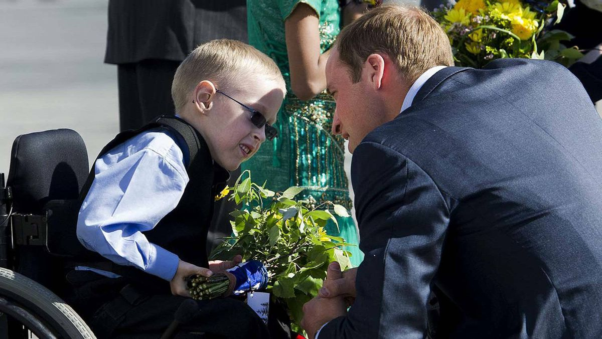 The Duke of Cambridge talks with six-year-old Riley Oldford, left, before departing Yellowknife for Slave Lake, Alta., on Wednesday, July 6, 2011.
