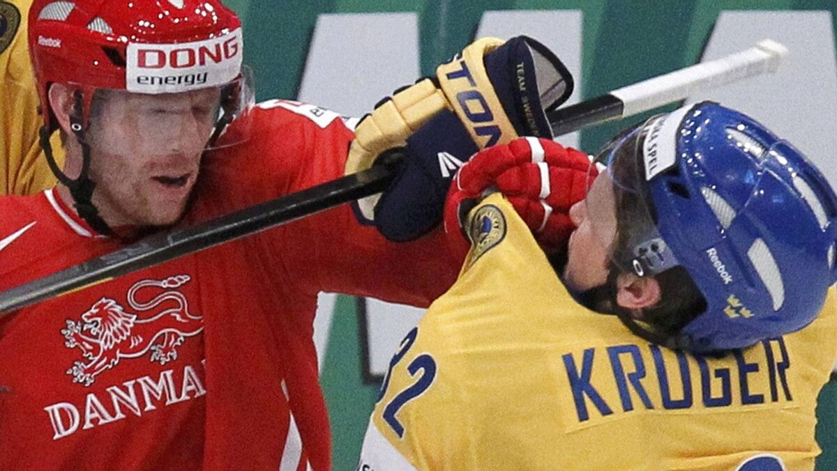 Denmark's Jannik Hansen (L) fights with Sweden's Marcus Kruger during their 2012 IIHF men's ice hockey World Championship game in Stockholm May 7, 2012. REUTERS/Petr Josek