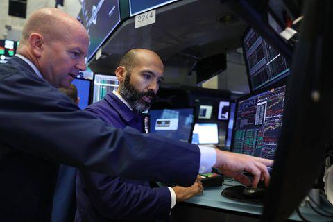 Wall Street dips on jobs data, drug chain drop