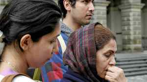 Mozhgan and Mehran Rasouli, wtih mother Parichehr Salasel, leave Ontario appeal court in Toronto on May 18, 2011.