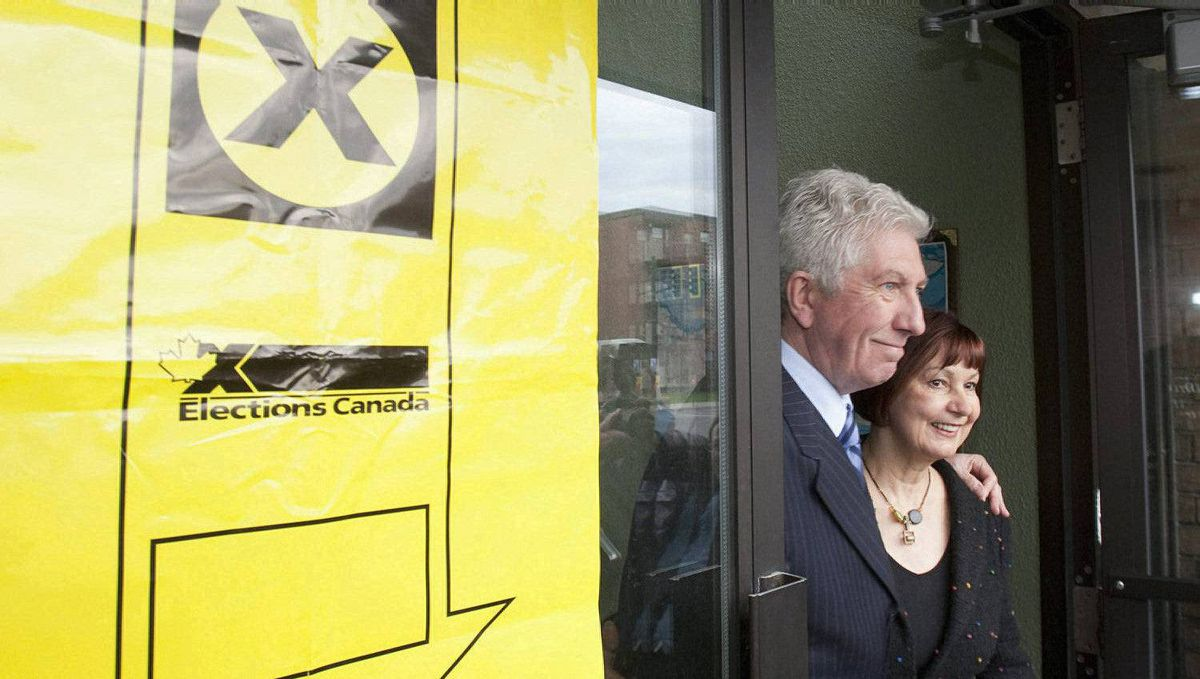 Bloc Quebecois Leader Gilles Duceppe and his wife Yolande Brunelle walk out of a polling station after they voted Monday, May 2, 2011 in Montreal. Canadians are going to the polls in a federal election .