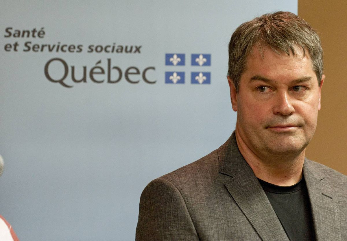 Quebec Health Minister Yves Bolduc takes questions on pathology testing at a news conference in Montreal on May 31, 2009.