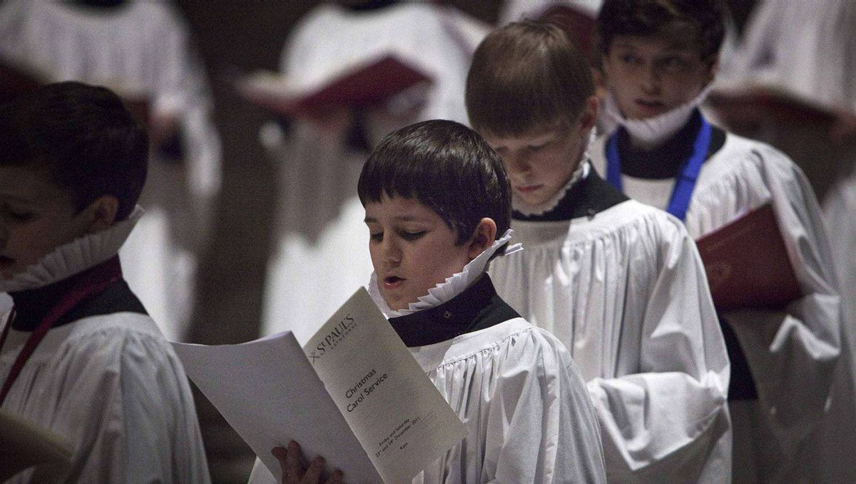 Choir boys sing during a Christmas eve choral service at St Pauls Cathedral in London December 24, 2011.