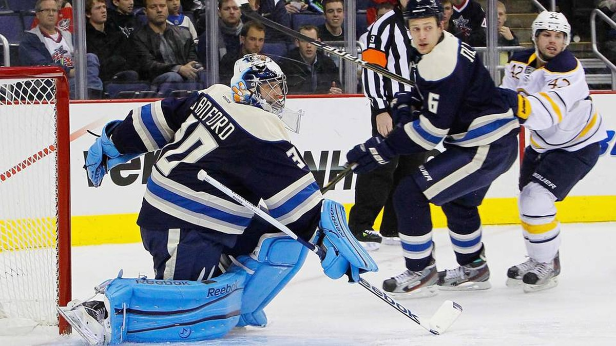 Columbus Blue Jackets goalie Curtis Sanford makes a save against the Buffalo Sabres during the second period at Nationwide Arena.