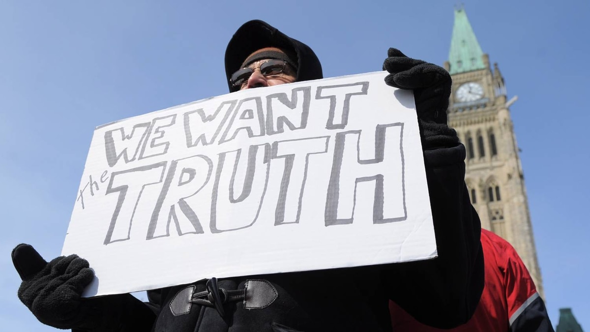 A protester decries alleged voter suppression during the 2011 federal election at a small gathering on Parliament Hill on March 5, 2012.