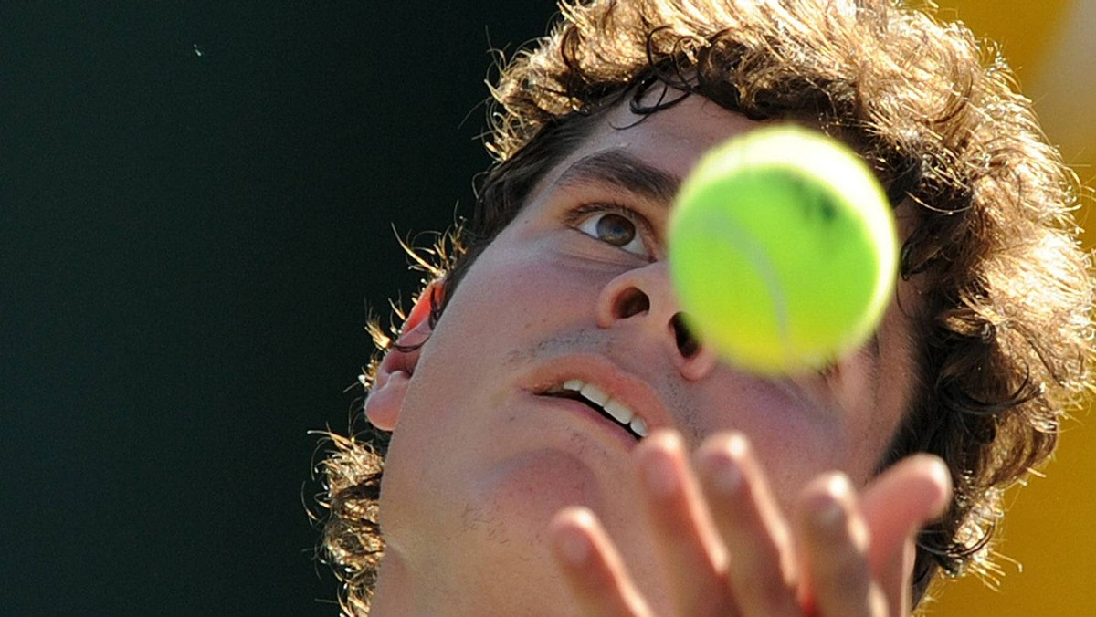 Canada's Milos Raonic serves the ball during his match against Ryan Harrison of the US during the Masters 1000 tournament in Indian Wells, California on March 15, 2011. Getty Images / GABRIEL BOUYS