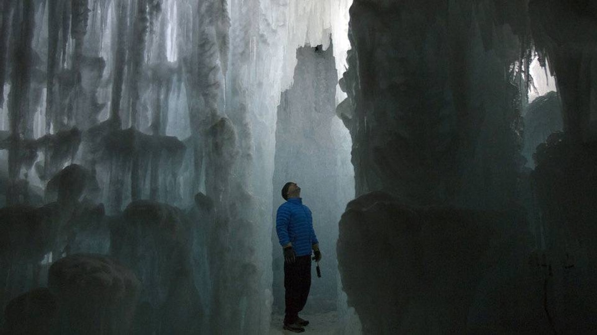 Jon Whinston looks at formations at the Ice Castles at Silverthorne in Colorado, January 3, 2012. The Ice Castles consist of man-made walkways, tunnels and arches of ice with no supporting structures.