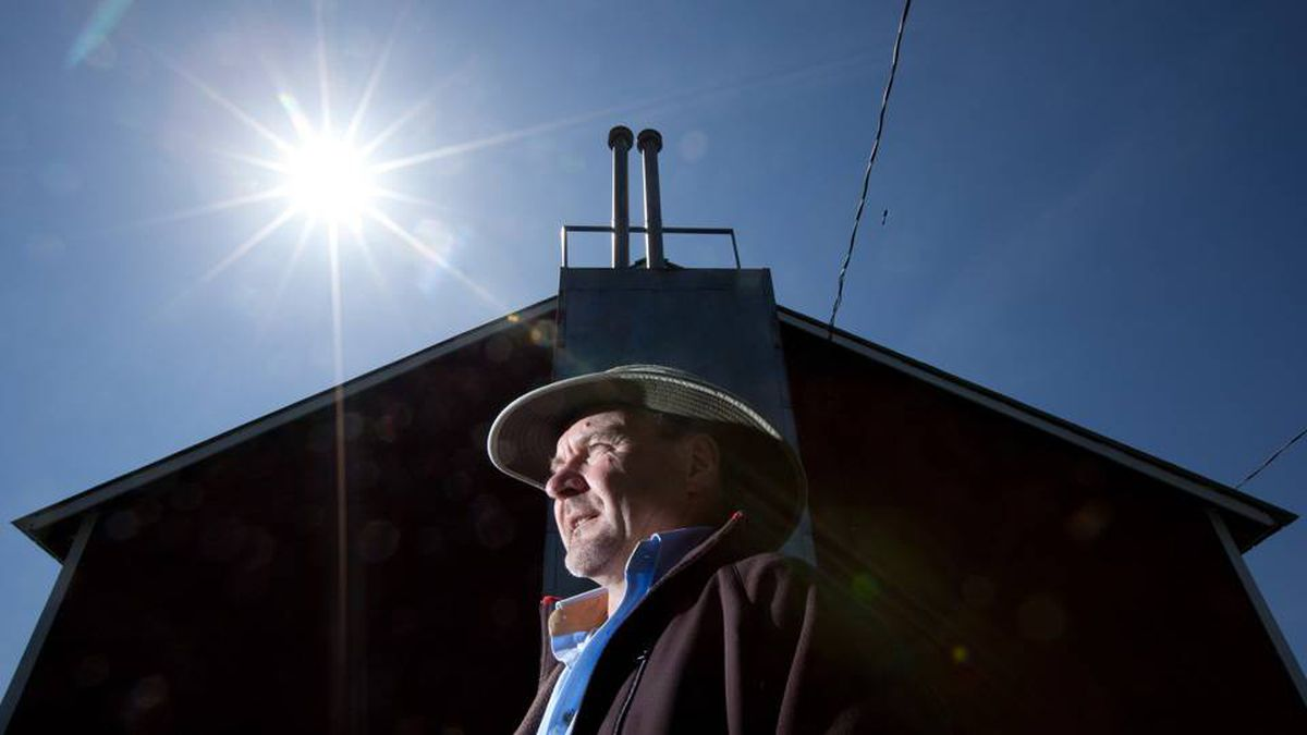 Former tobacco farmer Joe Botscheller stands near one of his old tobacco kilns on his windham Centre, Ont., farm. With demand for tobacco falling, he is looking to harvest solar energy as one of the ways to save his business.