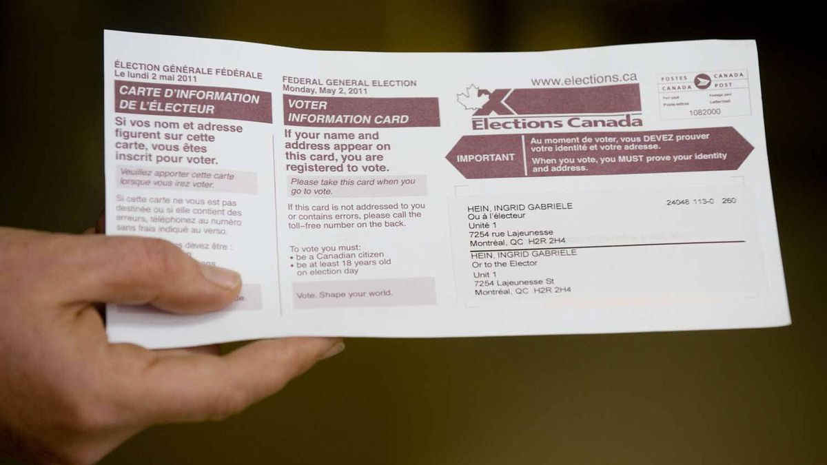 Ingrid Gabriele Hein displays her voting card prior to casting her ballot in Montreal on Monday.