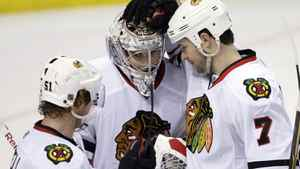 Chicago Blackhawks goalie Corey Crawford (50) is congratulated by teammates Brent Seabrook (7) and Brian Campbell (51) after the Blackhawks beat the St. Louis Blues 5-3 in an NHL hockey game Monday, Feb. 21, 2011, in St. Louis. (AP Photo/Tom Gannam)