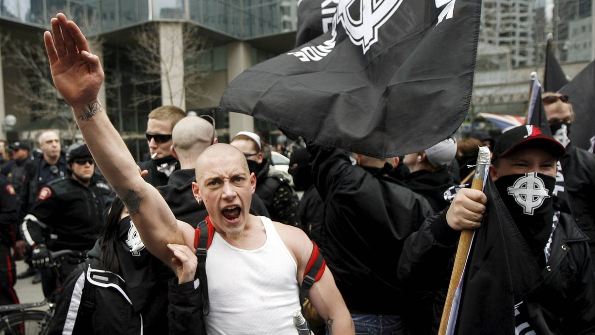 An Aryan Guard supporter salutes at the 2009 White Pride rally.s