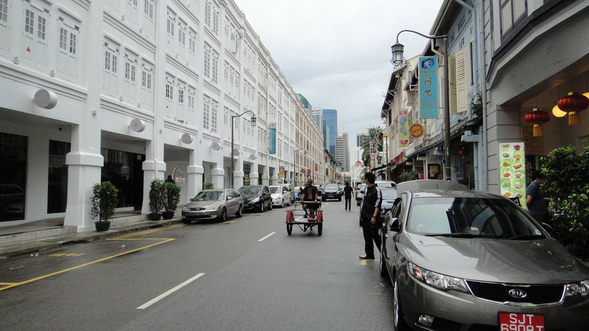 Janet Kerr photo: Streets of Singapore - The man in this photo riding the bicycle caught my eye as I visited Chinatown on a recent trip to Singapore.