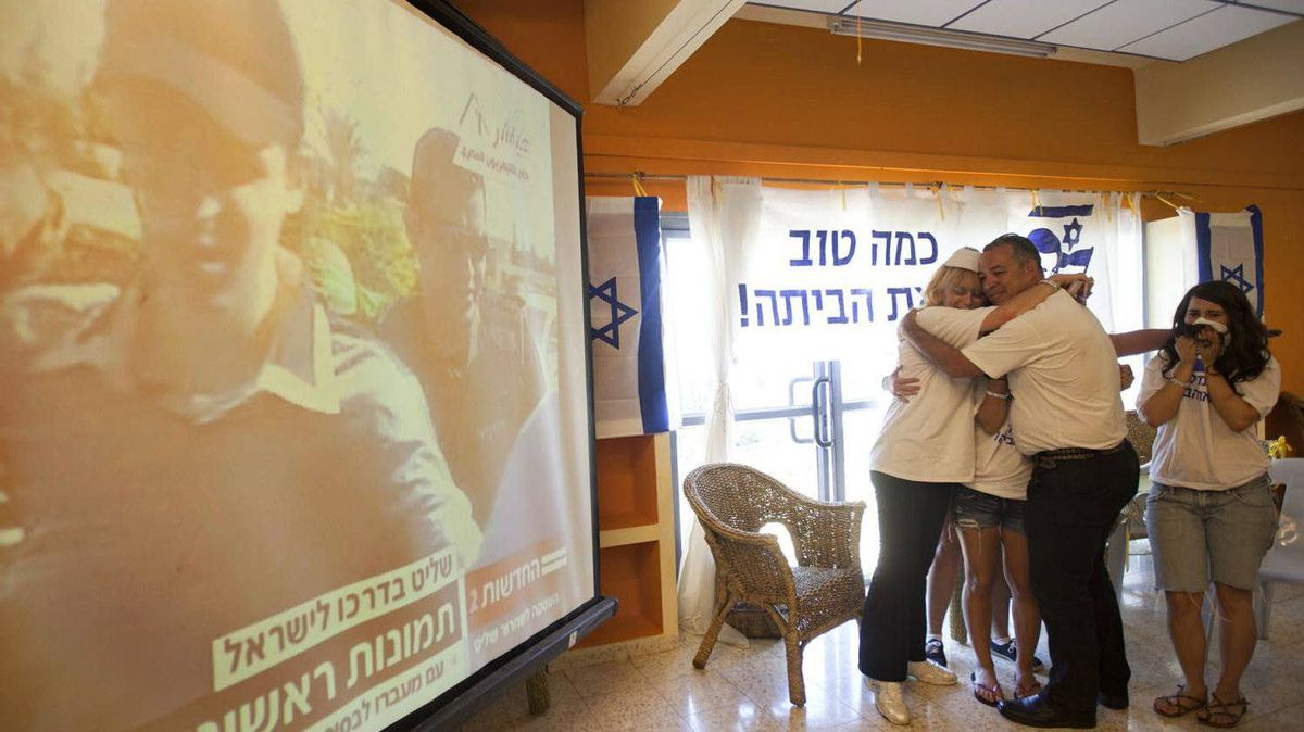 People hug as they see first images of Israeli soldier Gilad Shalit after more than five years in captivity, in Mitzpe Hila, northern Israel.