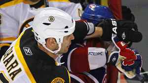 Boston Bruins defenseman Zdeno Chara (L) hits Montreal Canadiens Max Pacioretty into a glass stanchion during the second period of NHL hockey play in Montreal, March 8, 2011. According to media reports, Pacioretty suffered a broken vertebra and severe concussion on the play. Picture taken March 8, 2011.