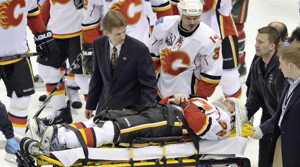 Calgary Flames center Daymond Langkow is taken from the game on a stretcher after being injured against the Minnesota Wild during the second period of an NHL hockey game Sunday, March 21, 2010, in St. Paul, Minn. Langkow was hit in the back of the neck with a puck and did not appear to be moving as he was removed from the ice on a stretcher. (AP Photo/Tom Olmscheid)