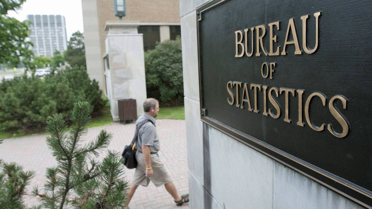 An employee makes his way to work at Statistics Canada in Ottawa on July 21, 2010.