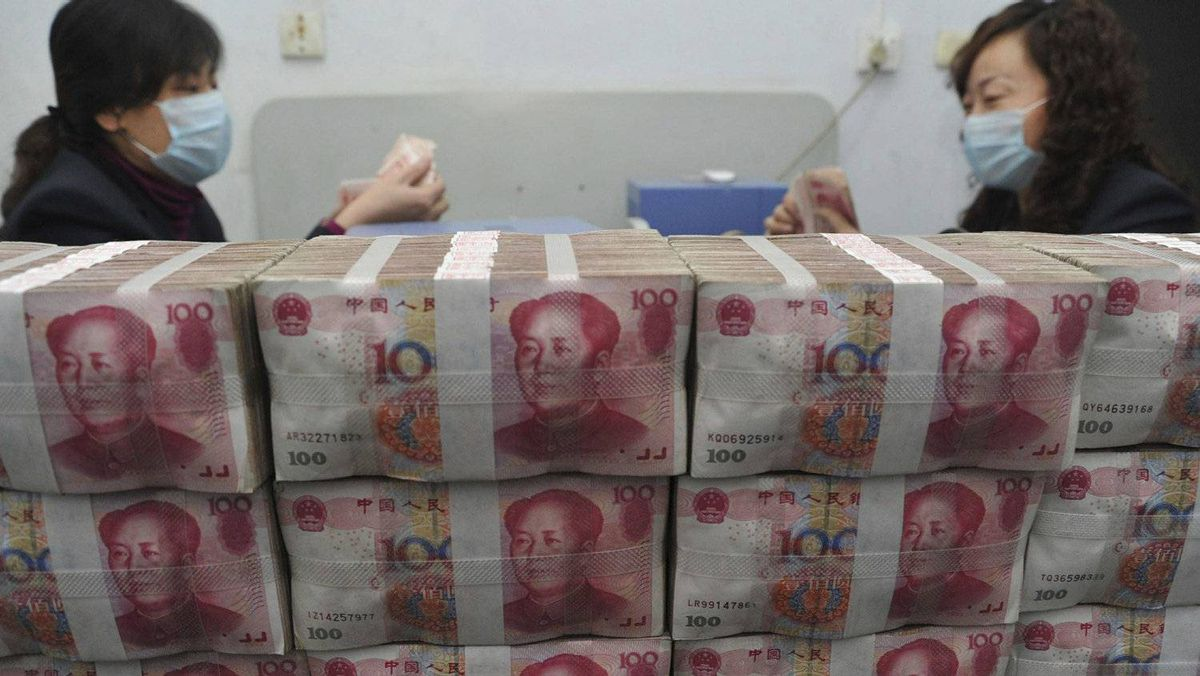 In this photo released by China's Xinhua news agency, staff members count bank notes at a rural credit union in Xinjiang County, north China's Shanxi Province, on Friday Jan. 14, 2011.