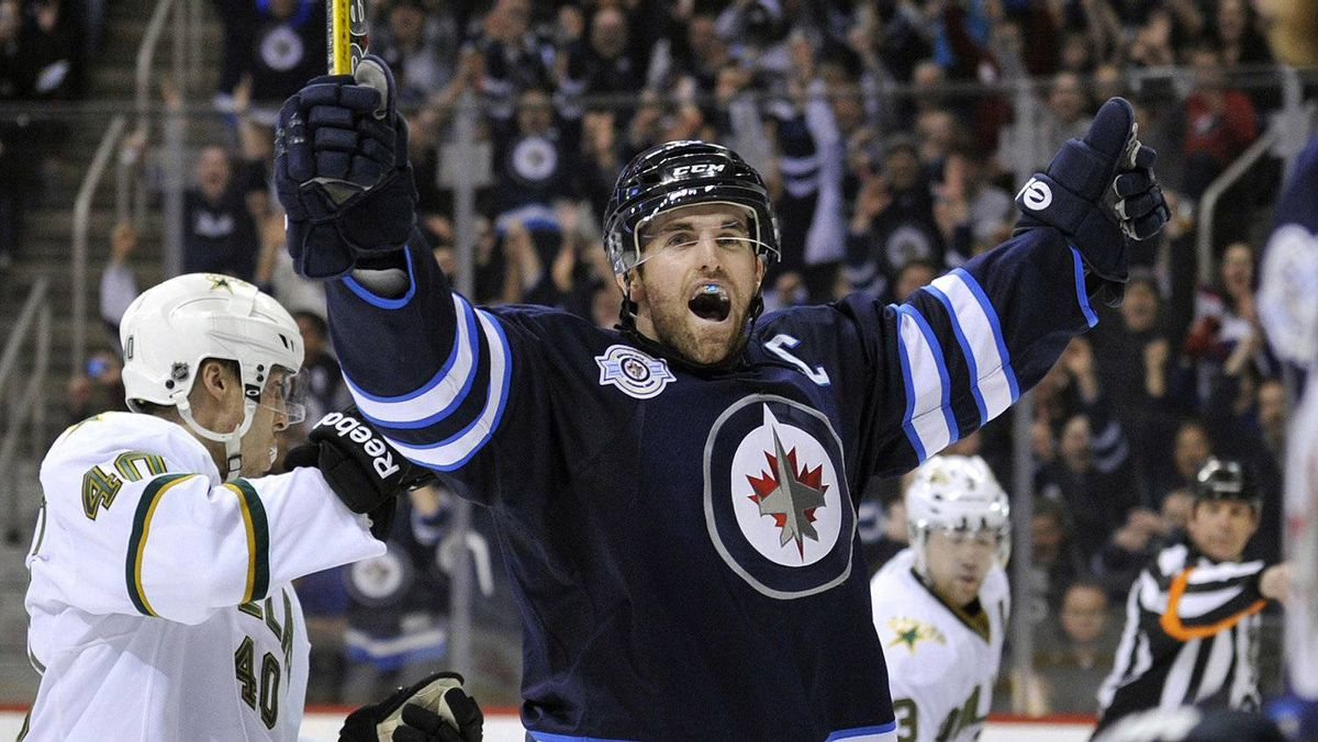 Winnipeg Jets Andrew Ladd celebrates his goal against the Dallas Stars during the second period of their NHL hockey game in Winnipeg March 14, 2012.