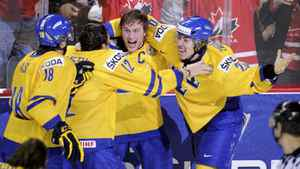 Sweden's Mika Zibanejad, right, celebrates after scoring the gold-medal clinching goal in overtime against Russia.