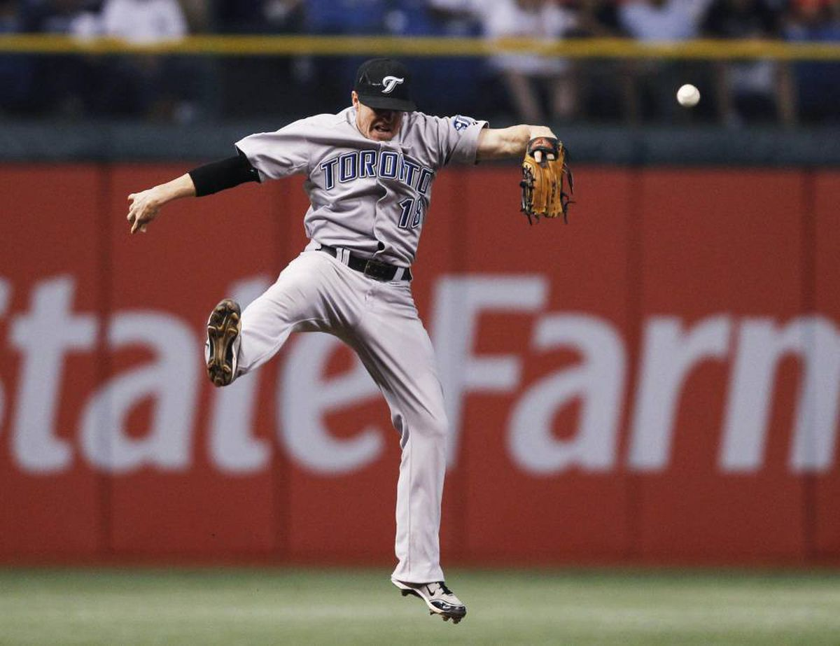 Toronto Blue Jays shortstop Mike McCoy leaps in the air missing a ball hit by the Tampa Bay Rays' Evan Longoria during the third inning of their MLB American League baseball game in St. Petersburg, Florida June 8, 2010.