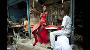 Vincent Boisot of France, a Riva Press photographer working for Le Figaro Magazine, has won the second prize Arts and Entertainment Singles with this picture of a model posing in front of tailor stalls in the center of Dakar, Senegal, July 9, 2011. She wears the creation of a designer, Yolande Mancini, participating in the 9th edition of Dakar Fashion Week.