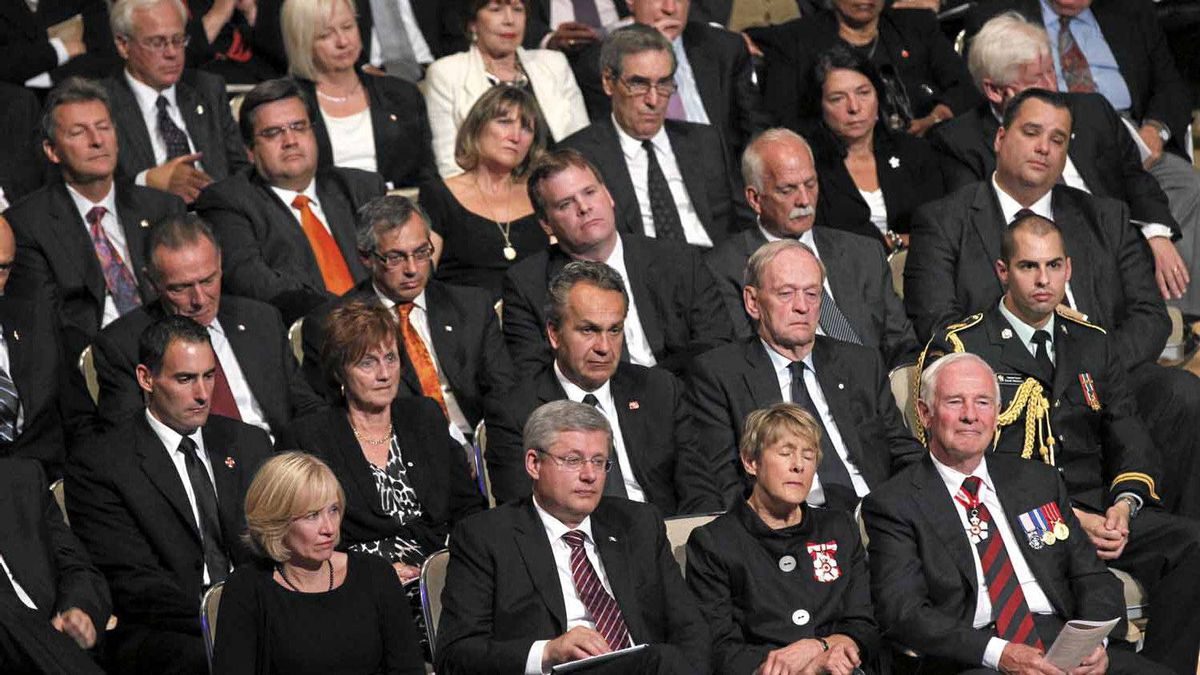 Dignitaries including Prime Minister Stephen Harper and his wife Laureen (bottom left) and Gov.-Gen. David Johnston and his wife Sharon (bottom right) attend the state funeral of the late NDP leader Jack Layton at Roy Thomson Hall in Toronto on Saturday, August 27, 2011.