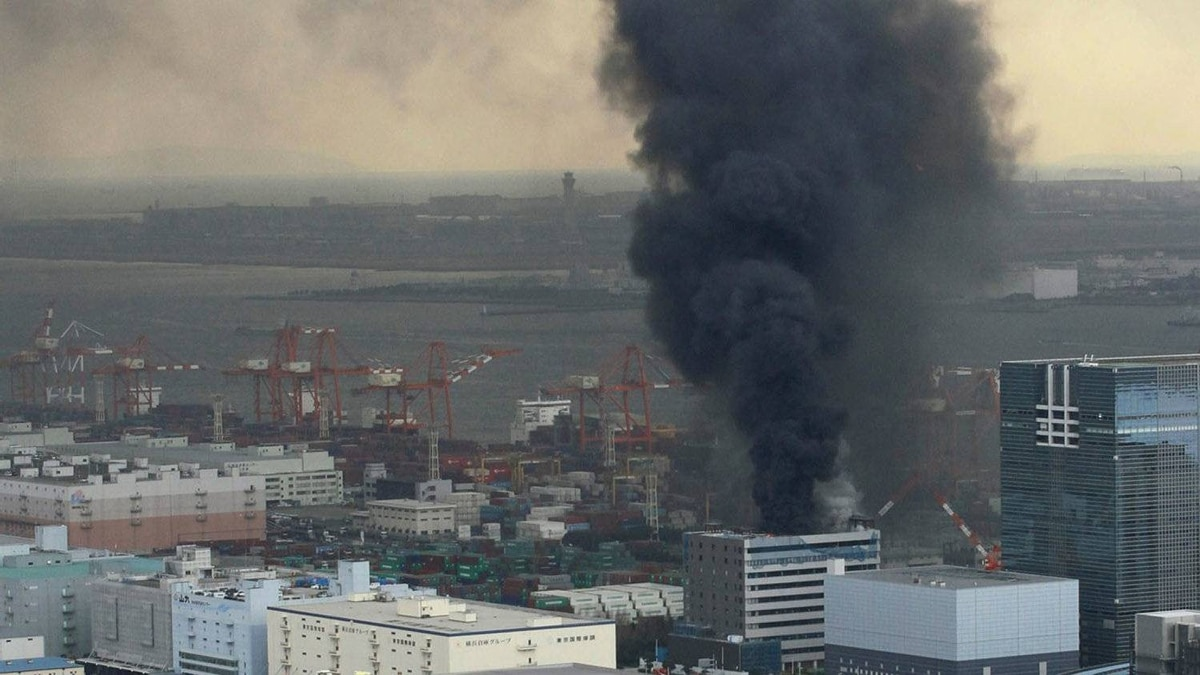 An office building burns in Tokyo after an earthquake.