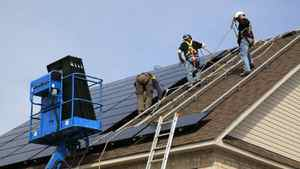 A crew installs solar panels on a house in Ontario. Natural Resources Minister Joe Oliver said Monday that the solar sector cannot expect any increase in support from Ottawa until the deficit is tamed.