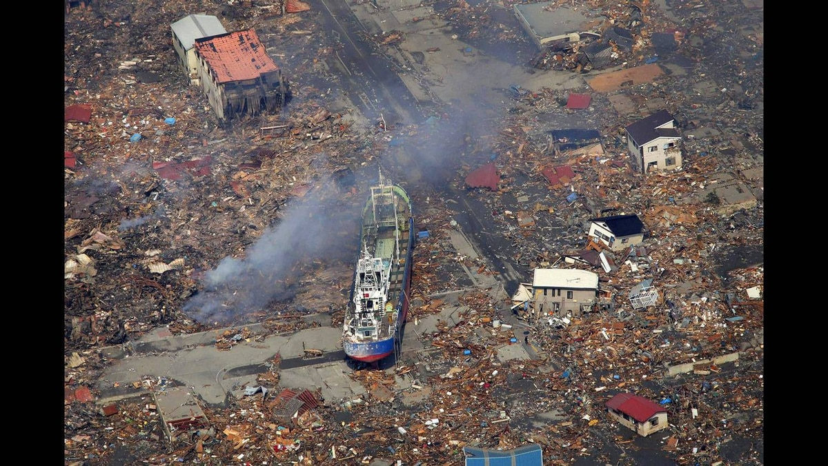 A ship washed away by a tsunami sits amid debris in Kesennuma, Miyagi Prefecture after Japan's biggest recorded earthquake hit its eastern coast March 13, 2011.