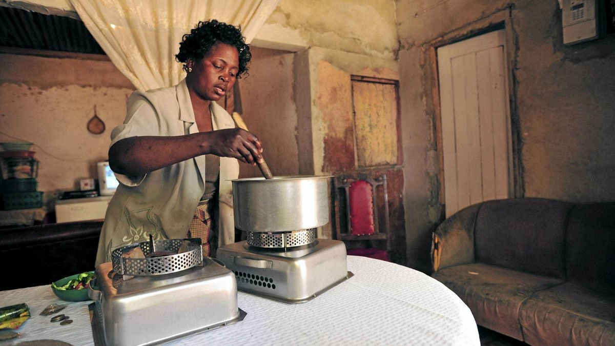 A woman in Mozambique uses an ethanol cookstove supplied by the Novozymes corporation to replace harmful, charcoal-based indoor stoves – and, not coincidentally, to expand its future markets for the ethanol it produces.