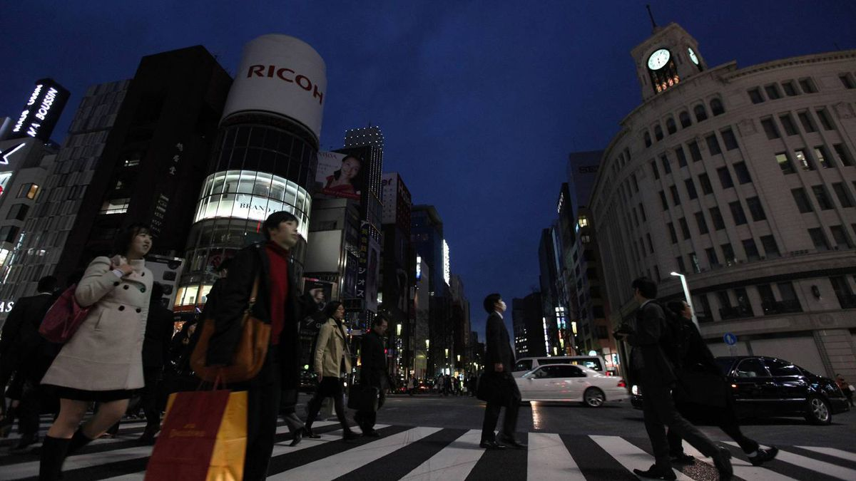 City lights and billboards are turned off at Tokyo's Ginza fashion district on Monday