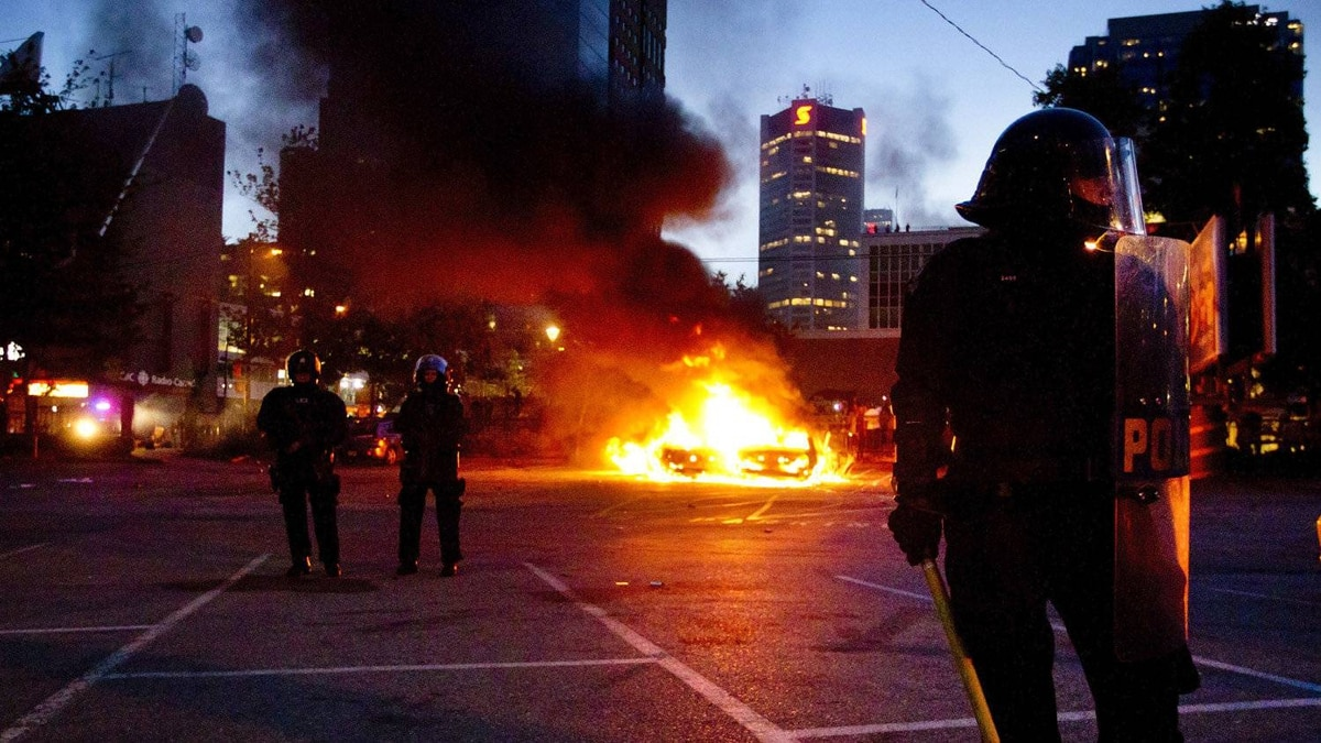 Riot officers in downtown Vancouver June 15, 2011 during the Stanley Cup riot.