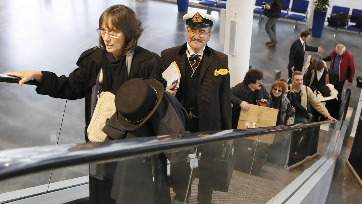 Maritime artist James Allan Flood (2nd L) of Del Ray Beach, Florida arrives wearing period costume to board the Titanic Memorial Cruise in Southampton, England April 8, 2012.