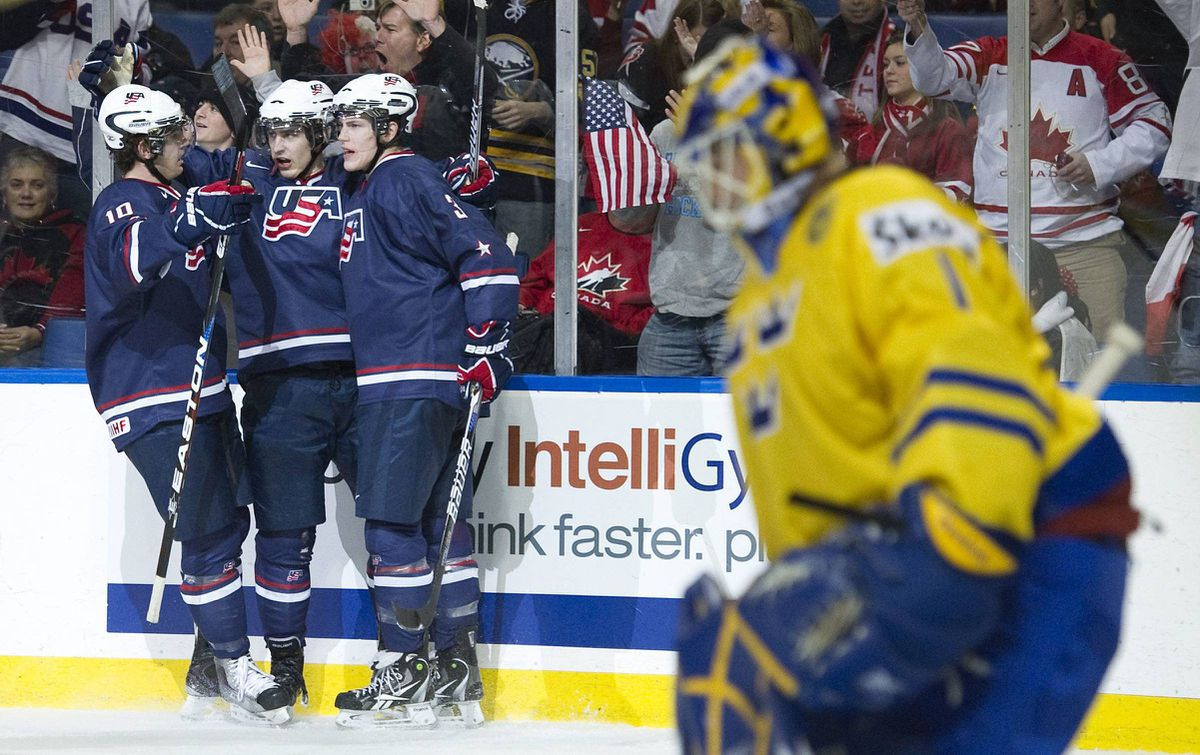 Team Sweden goalie Fredrik Wentzel Petersson (1) looks down after Team United States forward Chris Kreider, centre, celebrates with teammates Chris Brown, left, and Charlie Coyle, right, during second period IIHF World Junior Championship Bronze medal hockey action in Buffalo, NY, on Wednesday, January 5, 2011.