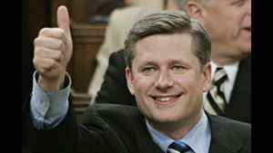 Stephen Harper gives a thumbs-up to his family during his non-confidence motion vote in the House of Commons triggering a federal election, in Ottawa Monday Nov. 28, 2005.