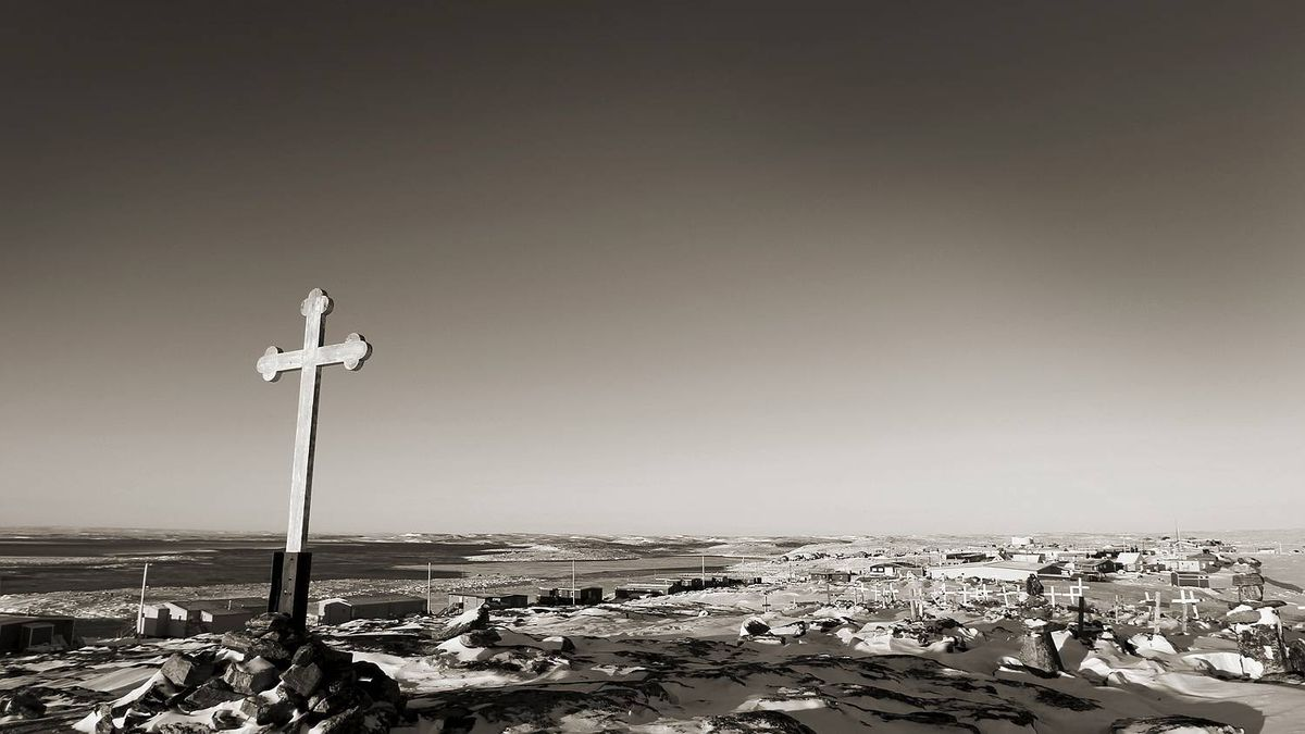A cross marks the high point of land in Repulse Bay, Nunavut on November 14, 2010. The Arctic Circle runs through this small northern hamlet.