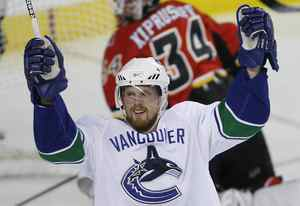 Vancouver Canucks forward Daniel Sedin celebrates a goal last season.