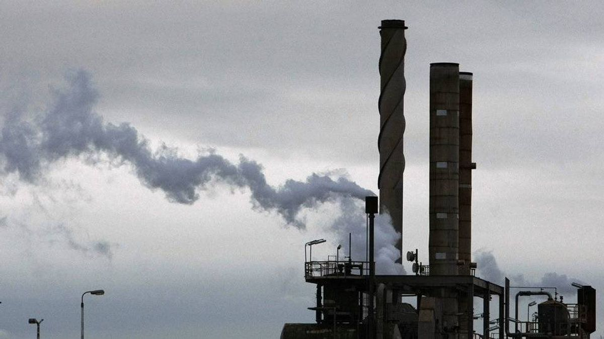 Steam and emissions are seen coming out of a funnel at an oil refinery in Melbourne.