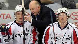 Washington Capitals head coach Bruce Boudreau talks to Alexander Semin #28 and Nicklas Backstrom #19 on the bench in a game against the Winnipeg Jets in NHL action at the MTS Centre on November 17, 2011 in Winnipeg, Manitoba, Canada. Boudreau is closing in on 200 wins ahead of Saturday's clash in Toronto with the Maple Leafs. (Photo by Marianne Helm/Getty Images)