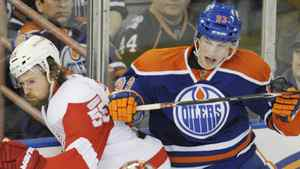 Edmonton Oilers' Ryan Nugent-Hopkins, right, dodges the Detroit Red Wings' Niklas Kronwall during first period NHL hockey game action in Edmonton on Saturday, February 4, 2012. THE CANADIAN PRESS/John Ulan