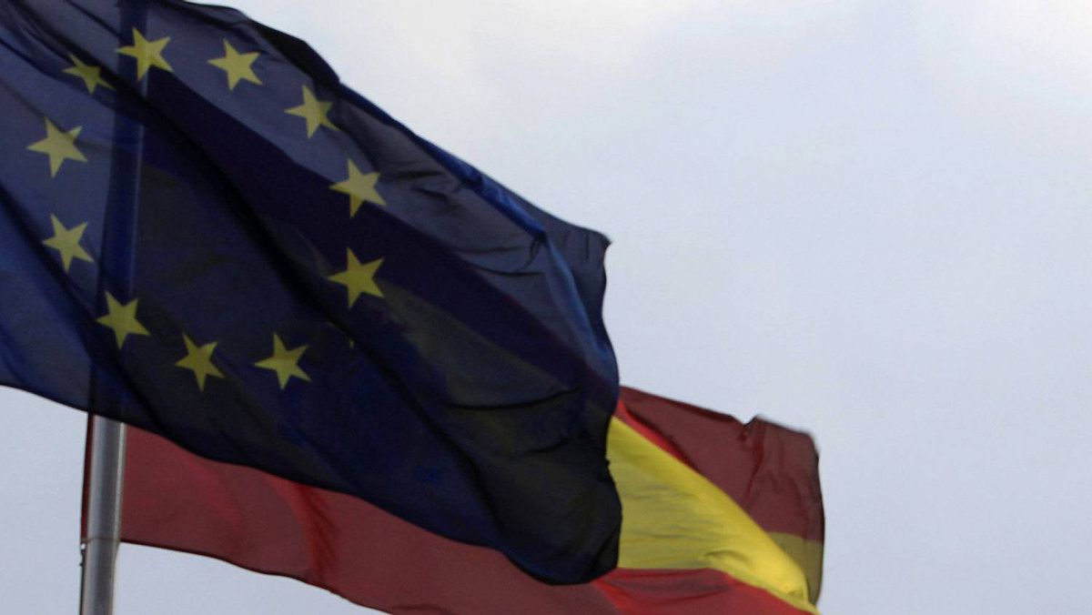 A European Union and a Spanish flag are seen beside the Bank of Spain building in central Madrid.
