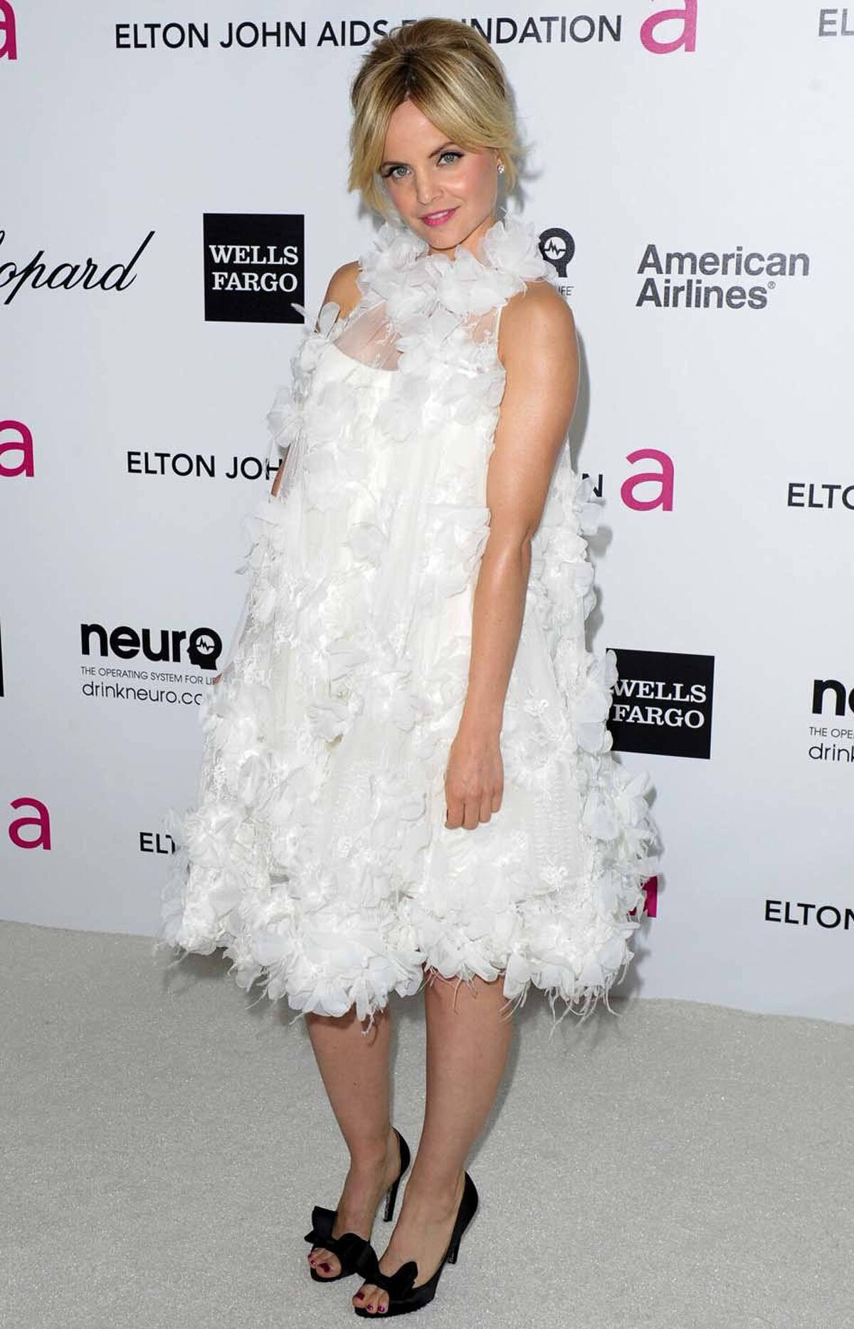 Mena Suvari wore Donald Duck to the annual Elton John AIDS Foundation Academy Awards Viewing Party in West Hollywood on Sunday. Seriously, unless you are Bjork there is no reason to wear a feather dress to a public event. At least, we ourselves can't think of a reason.
