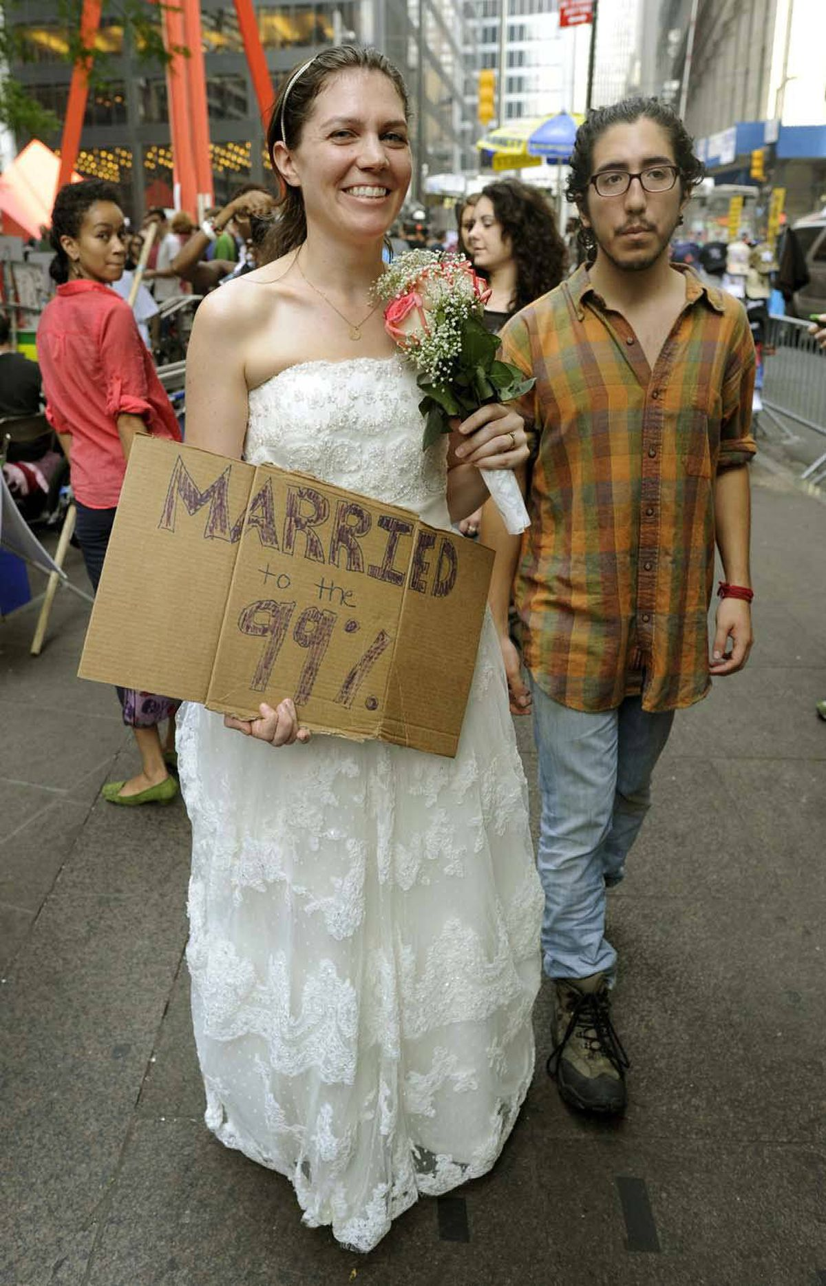 A couple of complete nobodies attend the Occupy Wall Street protest in New York on Monday.